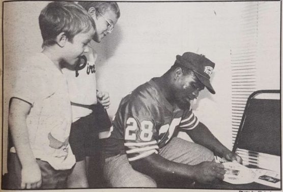 """""""Cougar cornerback Chuck Weatherspoon signs autographs for two young cancer patients"""". By mid-October the team was ranked number 6th nationally. 