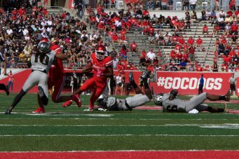 Greg Ward Jr. led the way for the Cougars in their second half comeback by scoring two touchdowns on the ground.   Ajani Stewart/The Cougar