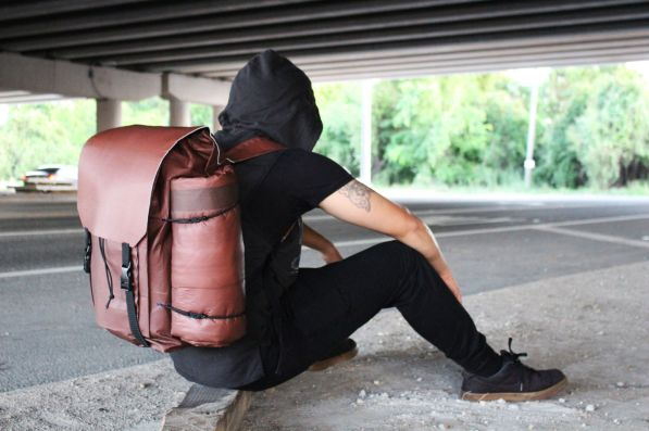 Strive by Jason Yang is a bag with an integrated sleeping roll that allows homeless users to rest in a warmer, more insulated bag while keeping their belongings safe. | Courtesy of Megan Street