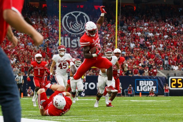 Senior cornerback Brandon Wilson hurdles a teammate on his way to a 109-yard field goal return touchdown against the University of Oklahoma Sept. 3. | Justin Tijerina/The Cougar