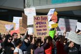 On Sunday, nearly 1,000 people gathered to protest President Donald Trump's travel ban, less than a block from Super Bowl LIVE. | Jasmine Davis/The Cougar
