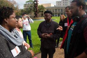 Bryan X (middle right) and a member of the New Black Panther Party who declined to give his name said it is time for a party to step in and make sure all oppressed people are protected, not just black or hispanic minorities. | Ajani Stewart/ The Cougar
