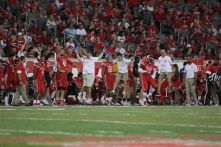 The Cougars celebrated early Saturday night after going up by 38 point by halftime. Most of the starters were pulled by the beginning of the third quarter. | Thomas Dwyer/The Cougar