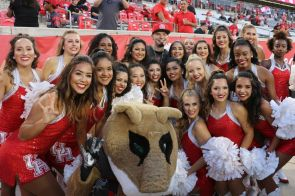 Houston rapper Paul Wall took pictures with fans, cheerleaders and players before the game, then introduced the team and walked out through the tunnel with players to start the game. | Thomas Dwyer/The Cougar