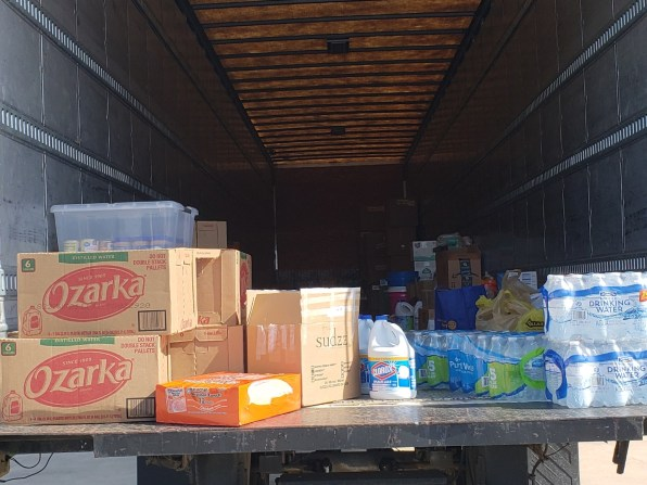 The supply drive started at 8 a.m. and by 10:30 a.m., the walls were starting to be lined by pallets of water and boxes of canned food. | Andres Chio/The Cougar