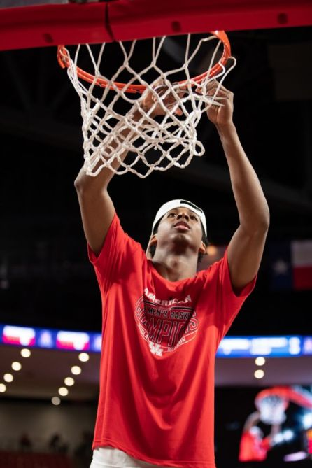 One of Houston's newest additions, freshman Nate Hinton, got to cut down the net in his first college season. | Ahmed Gul/The Cougar