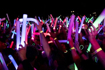 The partiers, adorned with glow sticks, waved light-up batons in time with the music. | Kathryn Lenihan/The Cougar