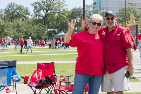 """Liz Childs did not go to UH, but feels like she has been accepted into the culture of UH, which her husband, Tom Childs, graduated from in 1981. """"We love it. We try to get out here as often as we can. We bring out grandson, and sometimes we've brought nieces and nephews, because it's just fun to come,"""" Liz said."""