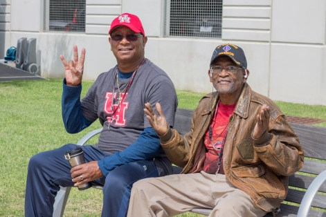 """Charlie Black (left), who is a 1984 computer science alum, and Willie White, who is a marine veteran, try going to most of the UH home games. """"I like it, it's a very good environment. Everybody is friendly,"""" Black said."""