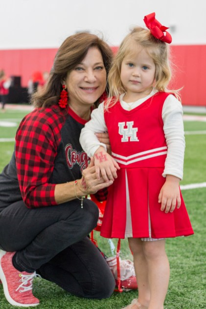 """Barbara Hermis and her 3-year-old granddaughter attended the RedZone tailgating experience before the game. """"I'm a lifetime member, and my husband is an alum. I love it. We always have a good time,"""" Hermis said."""