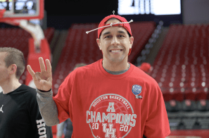 Assistant coach Kellen Sampson, with his piece of the net tied to his hat, shows off Houston's regular season title shirt.   Mikol Kindle Jr./The Cougar
