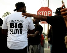 """A protester wears a shirt with """"Big Floyd"""" written on the back. The moniker served as Floyd's stage name when he made music in Houston during the '90s and early 2000s. Floyd, according to multiple reports, collaborated with Houston hip-hop legend DJ Screw. 