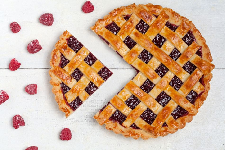 38264903 - sliced raspberry pie with fresh sugared raspberries on white table