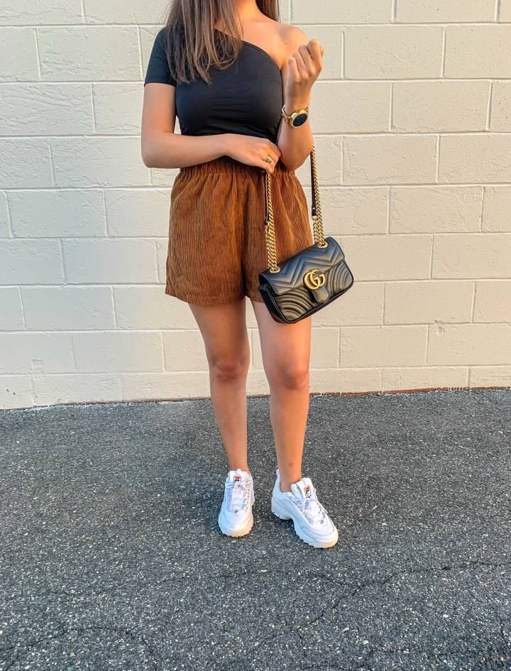 black one shoulder top and corduroy shorts 6