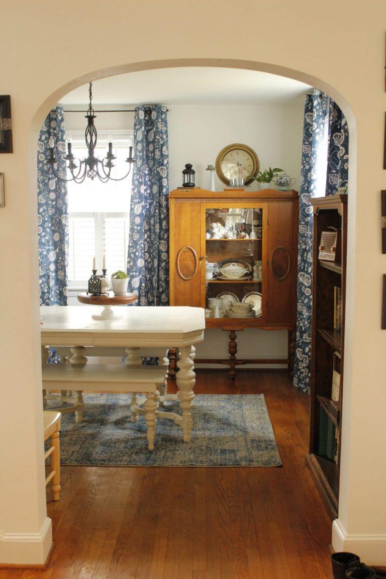 The dining room with the updated blue curtains and rug