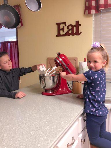 boy and girl baking cookies