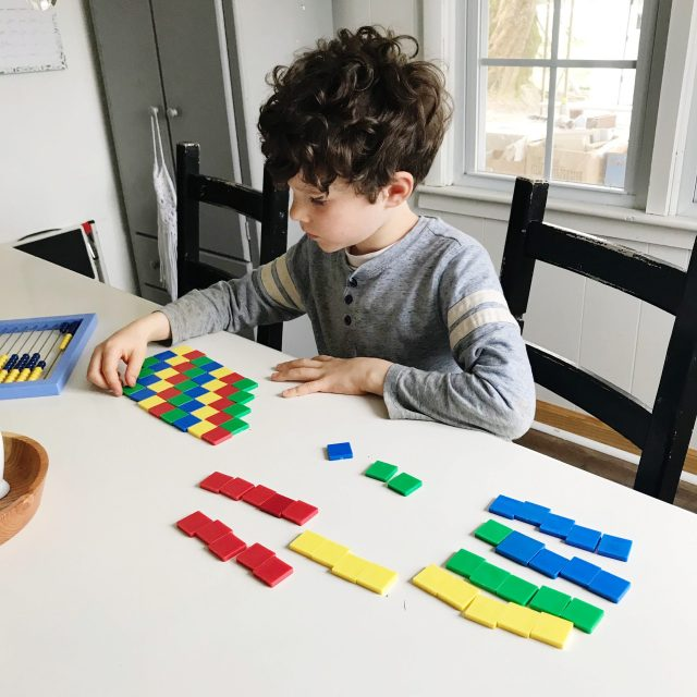 child playing with shapes at table