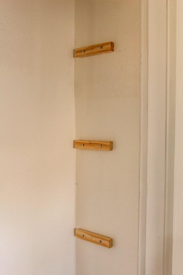shelf supports mounted on closet wall