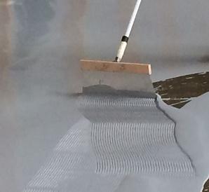 Damp proofing concrete floors with an epoxy floor coating