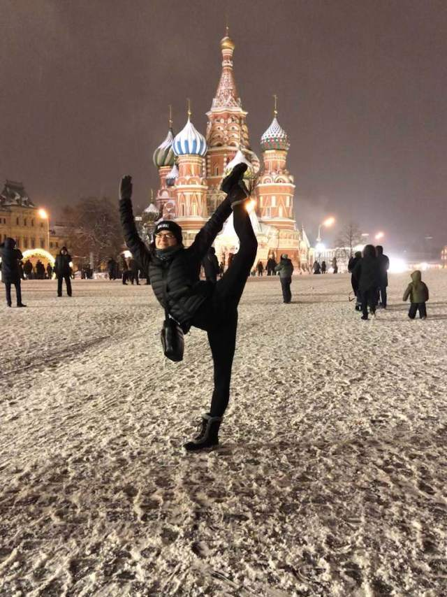 girl dancing in Red Square at night