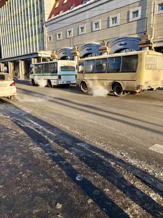 Old, tiny buses on Pretty russian building on karl marx street irkutsk russia