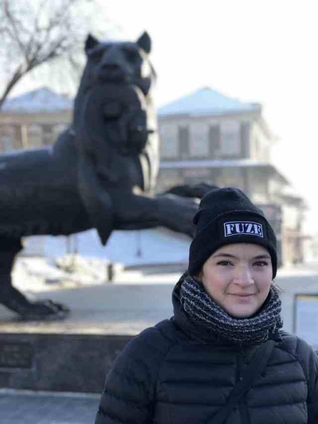 girl in front of babr statue irkutsk
