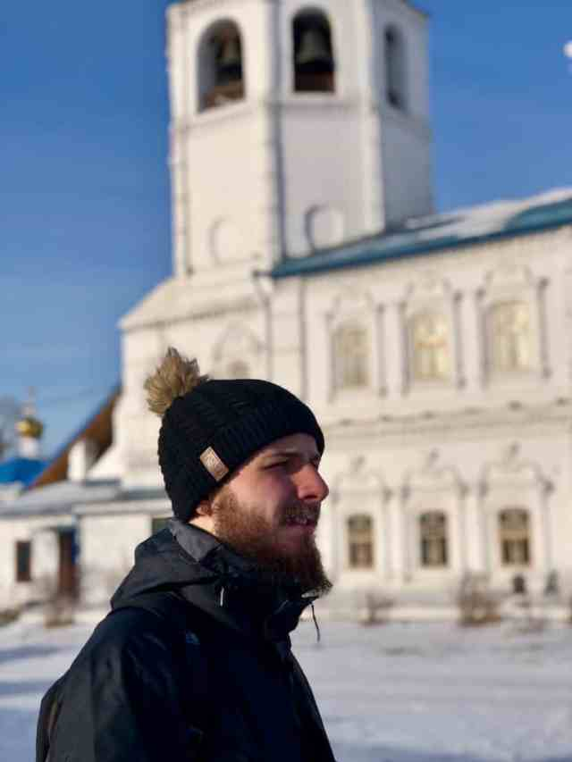 boy standing in front Holy Odigitrievsky Cathedral