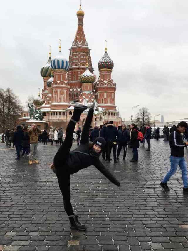 Girl kicking in front of St Basils Cathedral in Moscow, 4 Nights in Moscow