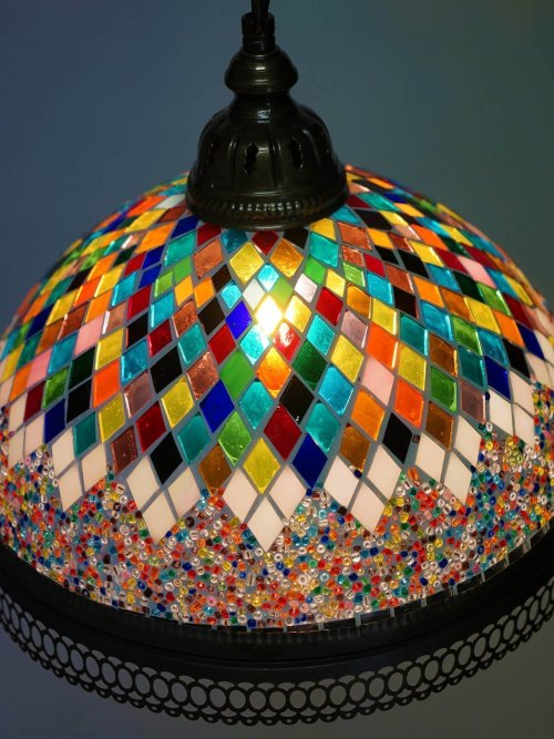 Large stained glass pendant light close up looking down light on