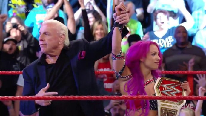 Ric Flair raises Sasha's hand