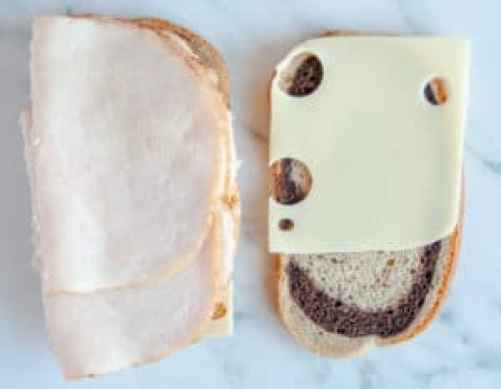 Open faced sandwich with swiss cheese, thousand island dressing and deli turkey