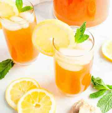 Homemade Lemonade Iced Tea in a glass garnished with mint and lemon