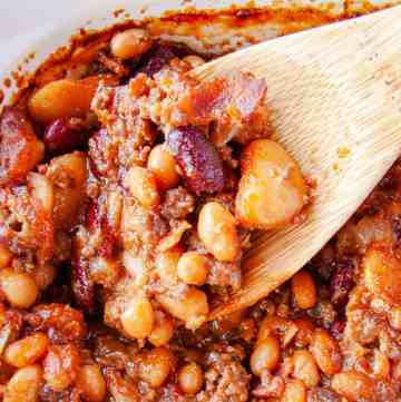 Wooden spoon scooping out Calico Baked Beans