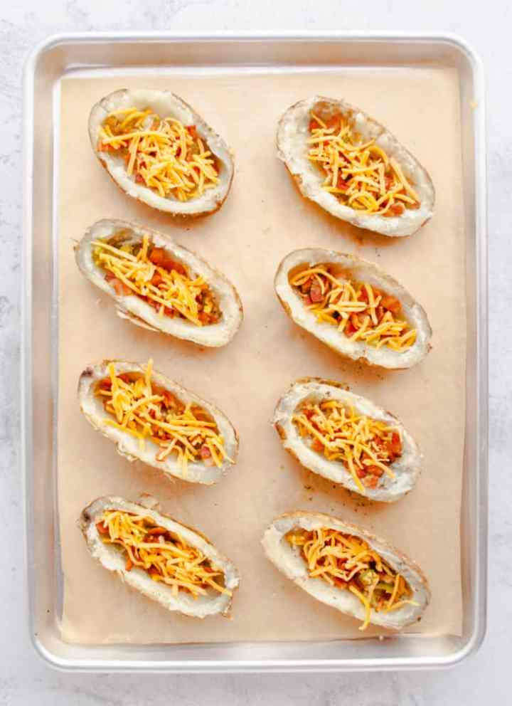 Potatoes stuffed with peppers, onions, bacon and cheese