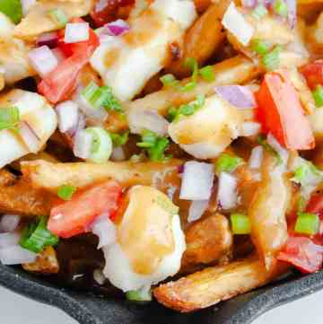 Overhead shot of Poutine Fries in black pan