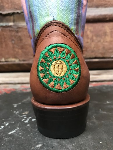"""The Theda Sandiford Artist Boot in collaboration with Planet Cowboy Boots. -13"""" tall boot -J toe -1 1/2"""" stacked leather heel -full leather sole -Canvas on Leather top replicating Theda Sandifords are Piece -Embroidery on foot on heel to compliment image. -handcrafted in Mexico by Planet Cowboy *Limited size run available"""