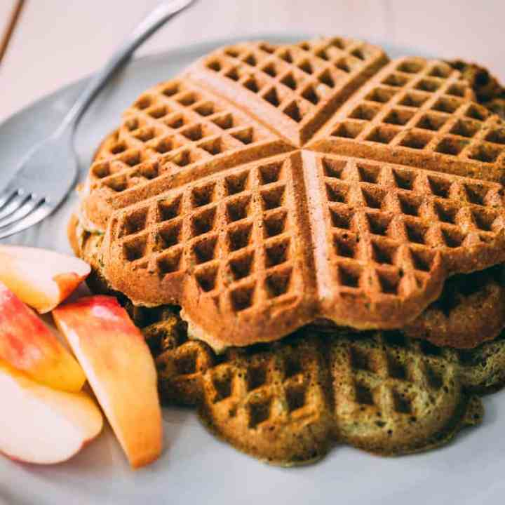 Stack of Healthy Green Smoothie Waffles sit on a plate ready to eat and enjoy.