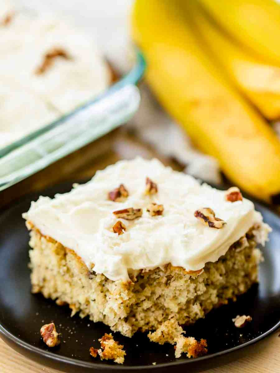 Piece of banana cake sits on a plate ready to enjoy.