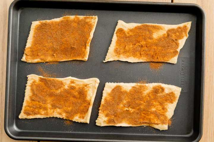 Crescent roll dough has been sprinkled with cinnamon sugar.