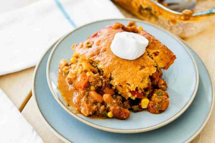 Serving of casserole sits on a plate ready to enjoy.