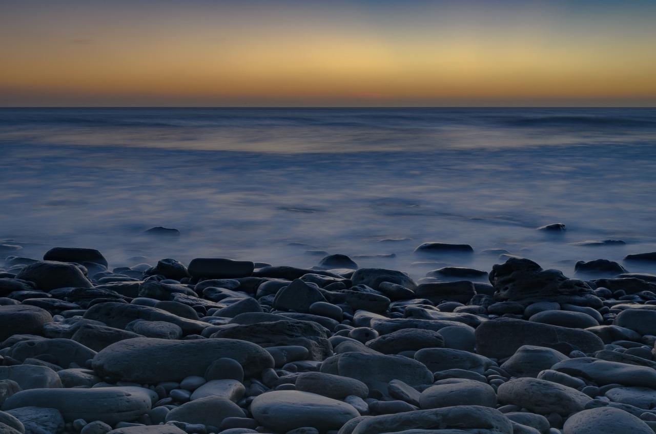 rocks by the seaside at sundown