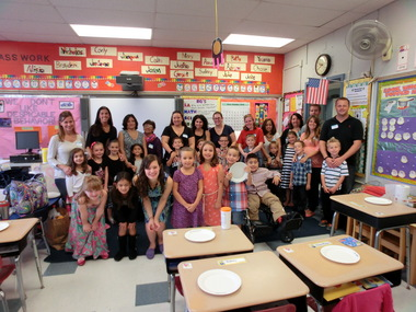 Valley Road first graders in Clark celebrate Johnny Appleseed Day