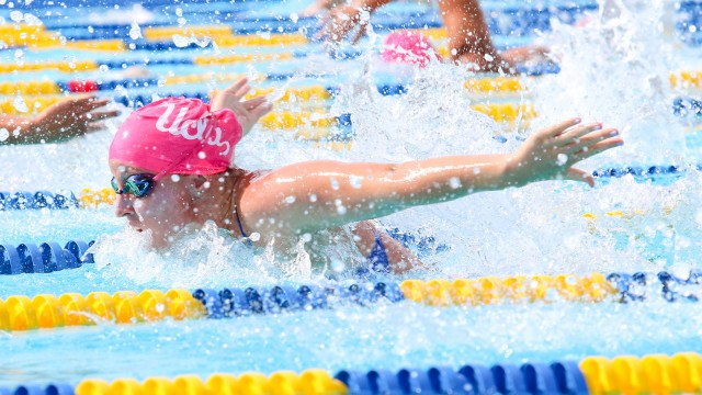 UCLA swimming sports pink caps to spread breast cancer awareness