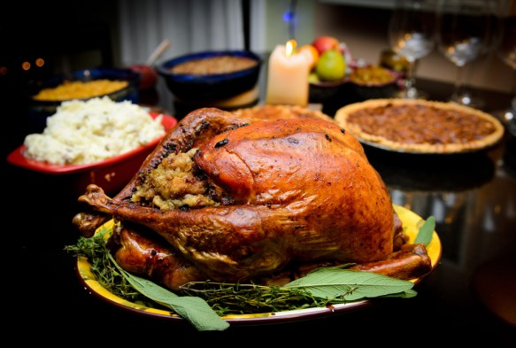 Turkey dinner with mashed potatoes, pie and other side dishes