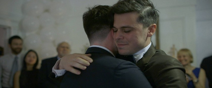 Still from the movie Crystal City of two men hugging
