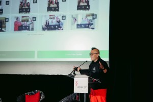 Terence Swee, of photobook.ai, demos AI technology for creating photobooks.