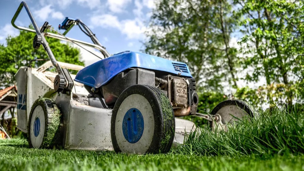 save water by doing your lawn care at the right times. Here a lawnmower in act