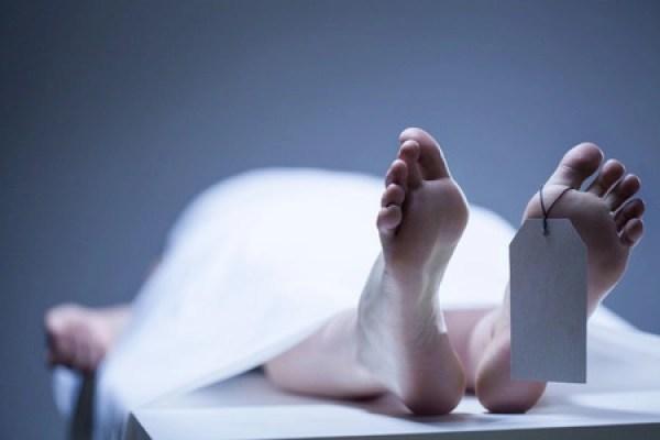 Body lying on a mortuary slab.