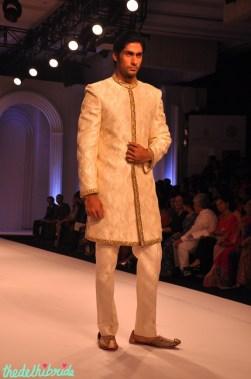 Classic off-white sherwani. No bling.