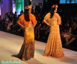 Fur shrugs worn over Chantilly lace evening gowns in the hues of beige and peach